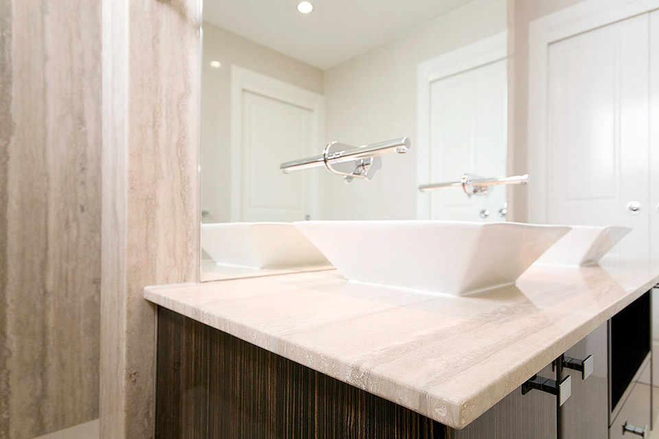 Travertine wall panels in bathroom